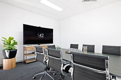 Brisbane boardroom with natural light and plants